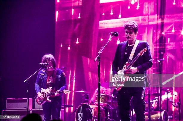 In this handout photo provided by Forum Photos Ryan Adams and John Mayer perform at The Forum on April 21 2017 in Inglewood California