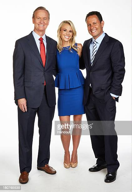 In this handout photo provided by FOX News Channel Steve Doocy Elisabeth Hasselbeck and Brian Kilmeade of 'Fox Friends' are seen in a portrait...