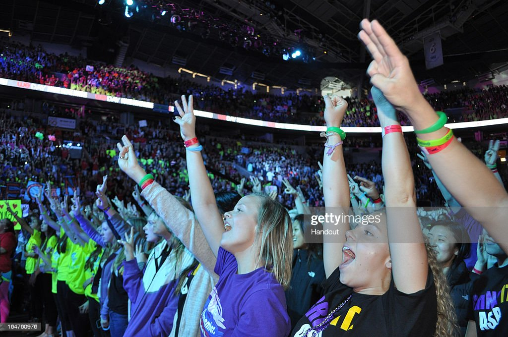 In this handout photo provided by Free The Children, 15,000 students cheer for social change at international charity and educational partner, Free The Children's, first ever We Day in the U.S.at the Key Arena on March 28, 2013 in Seattle, Washington.