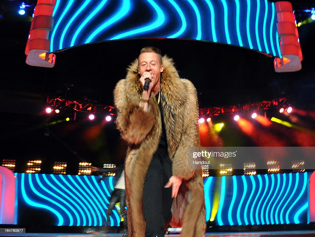 In this handout photo provided by Free The Children, Seattle music sensation <a gi-track='captionPersonalityLinkClicked' href=/galleries/search?phrase=Macklemore&family=editorial&specificpeople=7639427 ng-click='$event.stopPropagation()'>Macklemore</a> surprises the crowd of 15,000 youth with a show-stopping performance at the Key Arena on March 28, 2013 in Seattle, Washington.
