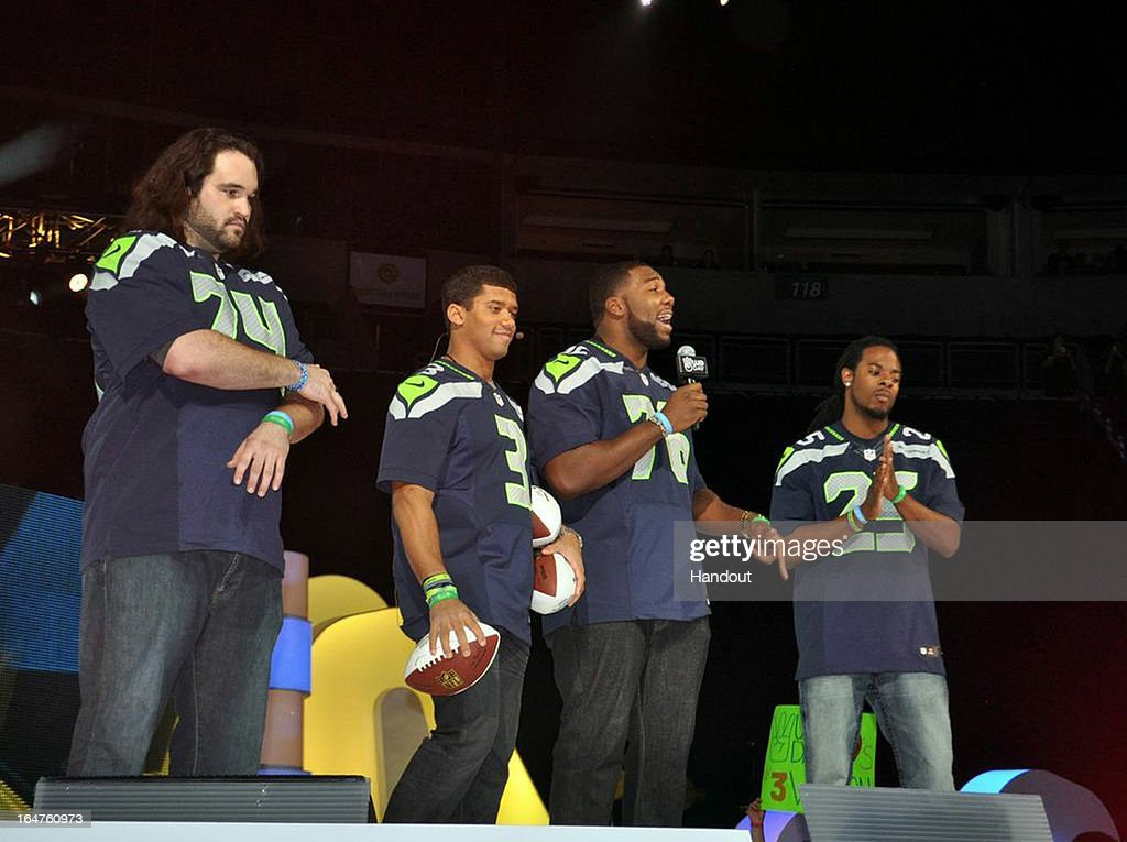 In this handout photo provided by Free The Children, Seattle Seahawks players John Moffitt (#74, Offensive Guard), <a gi-track='captionPersonalityLinkClicked' href=/galleries/search?phrase=Russell+Wilson+-+American+Football+Quarterback&family=editorial&specificpeople=2292912 ng-click='$event.stopPropagation()'>Russell Wilson</a> (#3, Quarterback), <a gi-track='captionPersonalityLinkClicked' href=/galleries/search?phrase=Russell+Okung&family=editorial&specificpeople=4046517 ng-click='$event.stopPropagation()'>Russell Okung</a> (#76, Offensive Tackle), and Richard Sherman (#25, Cornerback)show their support for youth activism in their community and honoring youth for their achievements at the first We Day Seattleat the Key Arena on March 28, 2013 in Seattle, Washington.