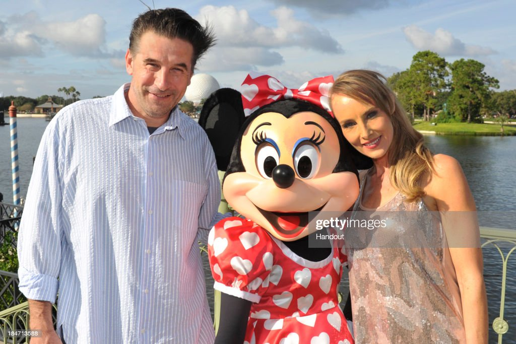 In this handout photo provided by Gene Duncan, actor William Baldwin and his wife, singer Chynna Phillips, pose with Minnie Mouse in Epcot at Walt Disney World Resort on October 15,2013 in Lake Buena Vista, Florida. Chynna Phillips, the lead singer of the musical trio Wilson Phillips, was performing at the theme park.
