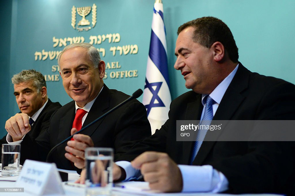 In this handout photo provided by GPO, (L-R) Finance Minister Yair Lapid, Prime Minister Benjamin Netanyahu and Transportation Minister Yisrael Katz during a press conference at the Prime Minister's Office on 3 July, 2013 in Jerusalem, Israel. Netanyahu presented a new planned sea ports reform where he announced the construction of two new ports at Haifa and Ashdod at a cost of $1.1 billion each.