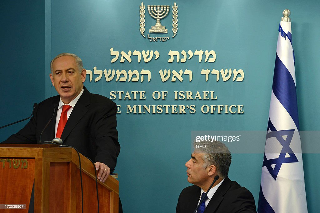 In this handout photo provided by GPO, Prime Minister Benjamin Netanyahu speaks during a press conference as Finance Minister Yair Lapid looks on at the Prime Minister's Office on 3 July, 2013 in Jerusalem, Israel. Netanyahu presented a new planned sea ports reform where he announced the construction of two new ports at Haifa and Ashdod at a cost of $1.1 billion each.