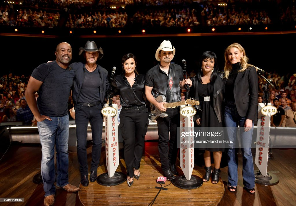 In this handout photo provided by Hand in Hand, Darius Rucker, Tim McGraw, Demi Lovato, Brad Paisley, CeCe Winans, and Faith Hill attend Hand in Hand: A Benefit for Hurricane Relief at the Grand Ole Opry House on September 12, 2017 in Nashville, Tennessee.