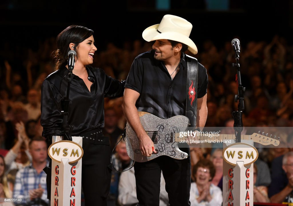 In this handout photo provided by Hand in Hand, Demi Lovato and Brad Paisley perform onstage during Hand in Hand: A Benefit for Hurricane Relief at the Grand Ole Opry House on September 12, 2017 in Nashville, Tennessee.