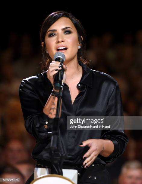 In this handout photo provided by Hand in Hand Demi Lovato performs onstage during Hand in Hand A Benefit for Hurricane Relief at the Grand Ole Opry...