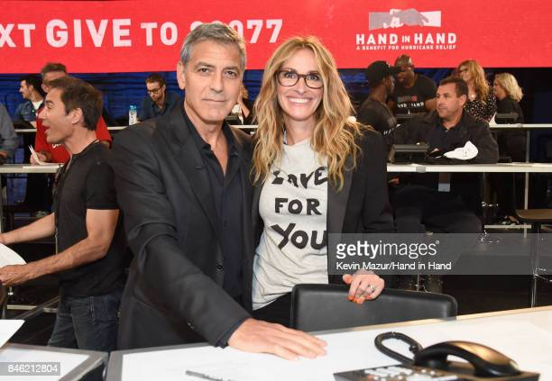 In this handout photo provided by Hand in Hand George Clooney and Julia Roberts attend Hand in Hand A Benefit for Hurricane Relief at Universal...