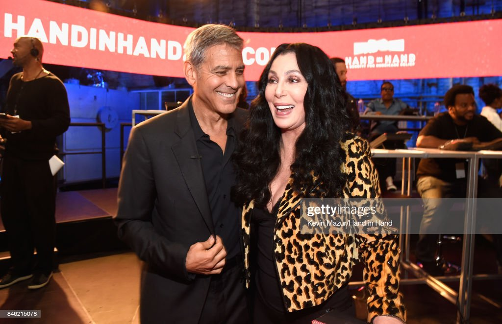 In this handout photo provided by Hand in Hand, George Clooney and Cher attend Hand in Hand: A Benefit for Hurricane Relief at Universal Studios AMC on September 12, 2017 in Universal City, California.