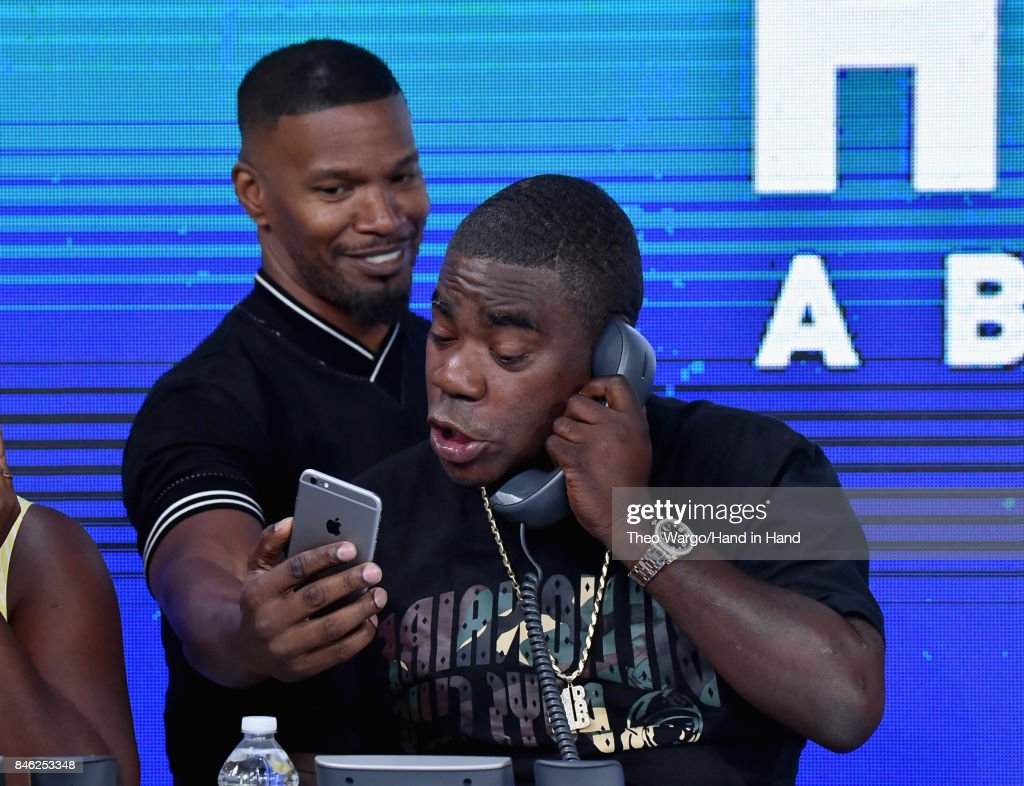 In this handout photo provided by Hand in Hand, Jamie Foxx and Tracy Morgan caption at ABC News' Good Morning America Times Square Studio on September 12, 2017 in New York City.