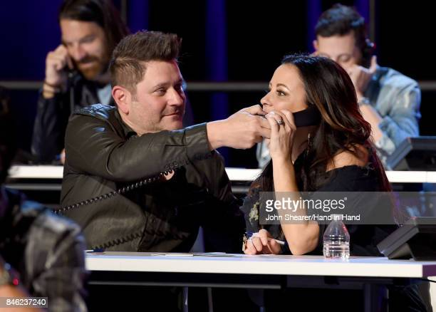 In this handout photo provided by Hand in Hand Jay DeMarcus and Sara Evans attend Hand in Hand A Benefit for Hurricane Relief at the Grand Ole Opry...