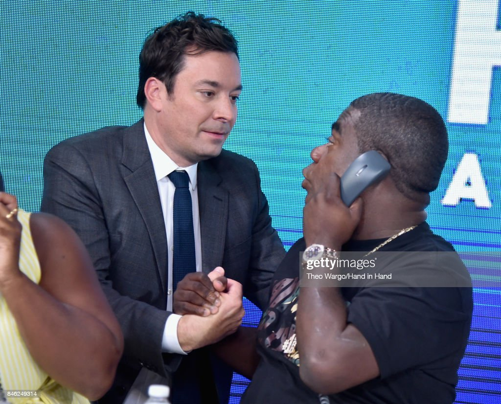 In this handout photo provided by Hand in Hand, Jimmy Fallon and Tracy Morgan caption at ABC News' Good Morning America Times Square Studio on September 12, 2017 in New York City.