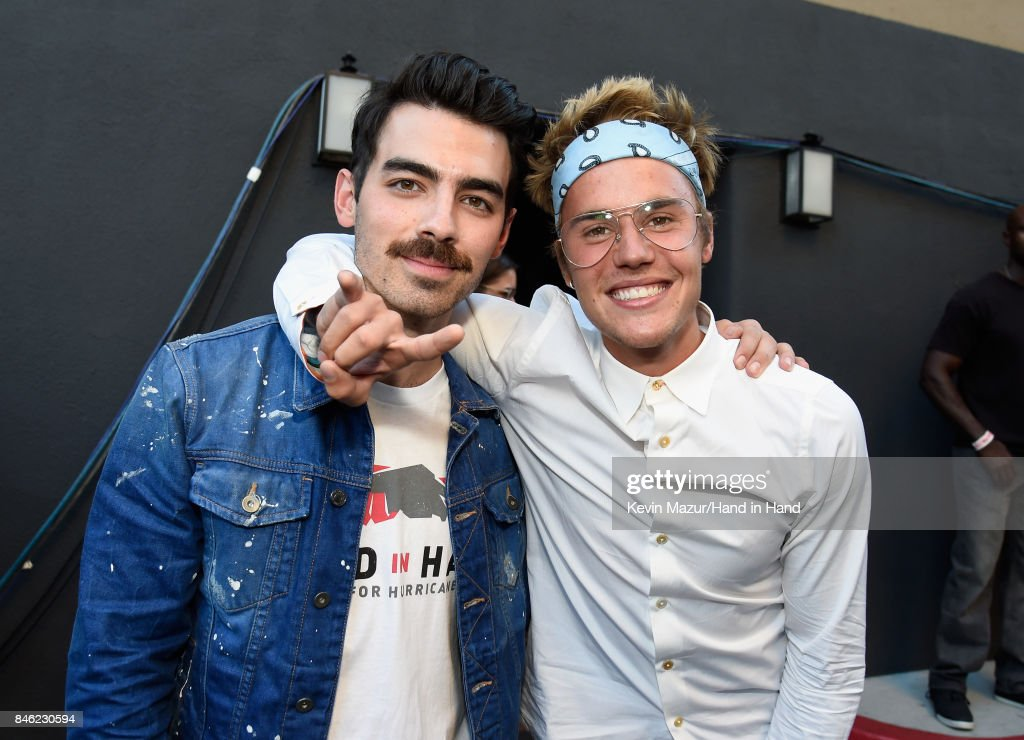 In this handout photo provided by Hand in Hand, Joe Jonas (L) and Justin Bieber attend Hand in Hand: A Benefit for Hurricane Relief at Universal Studios AMC on September 12, 2017 in Universal City, California.