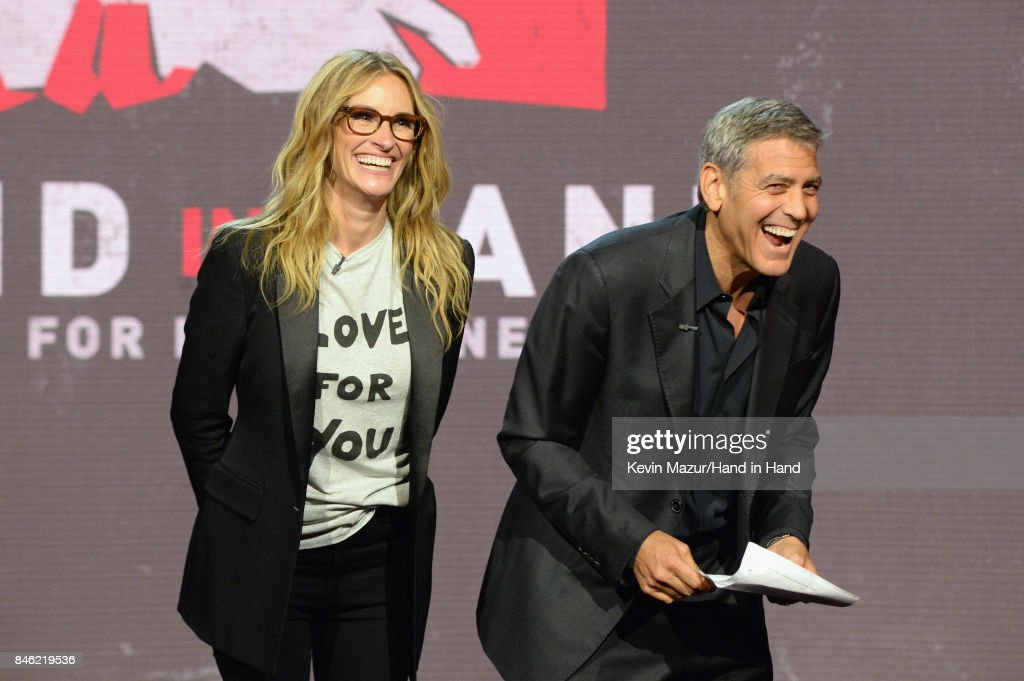 In this handout photo provided by Hand in Hand, Julia Roberts and George Clooney attend Hand in Hand: A Benefit for Hurricane Relief at Universal Studios AMC on September 12, 2017 in Universal City, California.