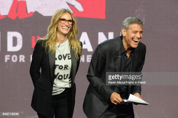 In this handout photo provided by Hand in Hand Julia Roberts and George Clooney attend Hand in Hand A Benefit for Hurricane Relief at Universal...