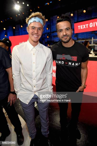 In this handout photo provided by Hand in Hand Justin Bieber and Luis Fonsi attend Hand in Hand A Benefit for Hurricane Relief at Universal Studios...