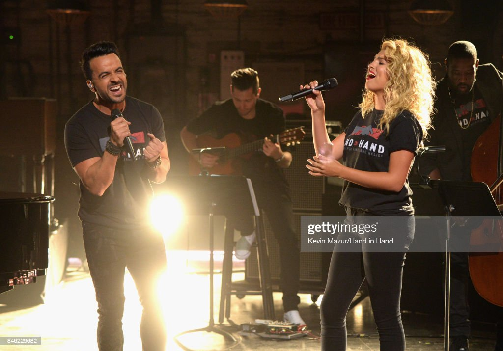 In this handout photo provided by Hand in Hand, Luis Fonsi and Tori Kelly perform during Hand in Hand: A Benefit for Hurricane Relief at Universal Studios AMC on September 12, 2017 in Universal City, California.