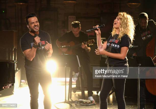 In this handout photo provided by Hand in Hand Luis Fonsi and Tori Kelly perform during Hand in Hand A Benefit for Hurricane Relief at Universal...