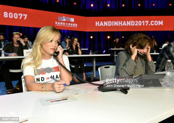 In this handout photo provided by Hand in Hand Reese Witherspoon and Amy Grant attend Hand in Hand A Benefit for Hurricane Relief at the Grand Ole...