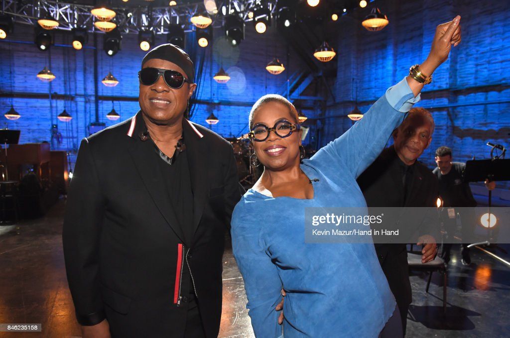 In this handout photo provided by Hand in Hand, Stevie Wonder and Oprah Winfrey attend Hand in Hand: A Benefit for Hurricane Relief at Universal Studios AMC on September 12, 2017 in Universal City, California.