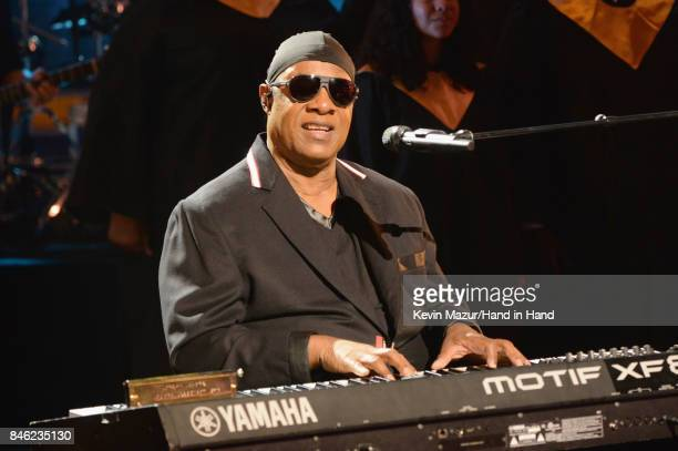 In this handout photo provided by Hand in Hand Stevie Wonder performs during Hand in Hand A Benefit for Hurricane Relief at Universal Studios AMC on...