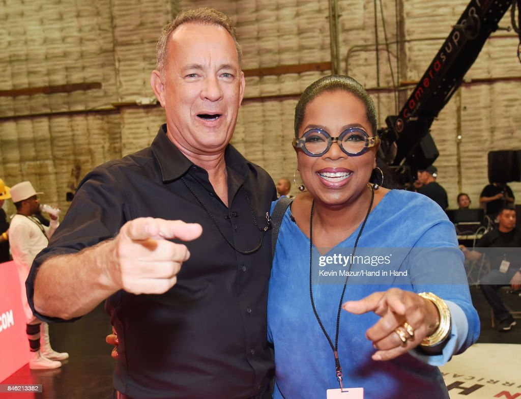 In this handout photo provided by Hand in Hand, Tom Hanks and Oprah Winfrey attend Hand in Hand: A Benefit for Hurricane Relief at Universal Studios AMC on September 12, 2017 in Universal City, California.