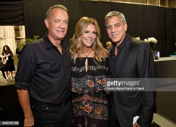 In this handout photo provided by Hand in Hand Tom Hanks Rita Wilson and George Clooney attend Hand in Hand A Benefit for Hurricane Relief at...