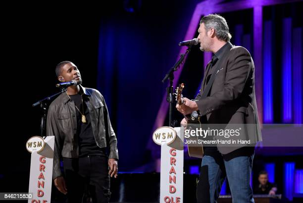 In this handout photo provided by Hand in Hand Usher and Blake Shelton perform onstage during Hand in Hand A Benefit for Hurricane Relief at the...