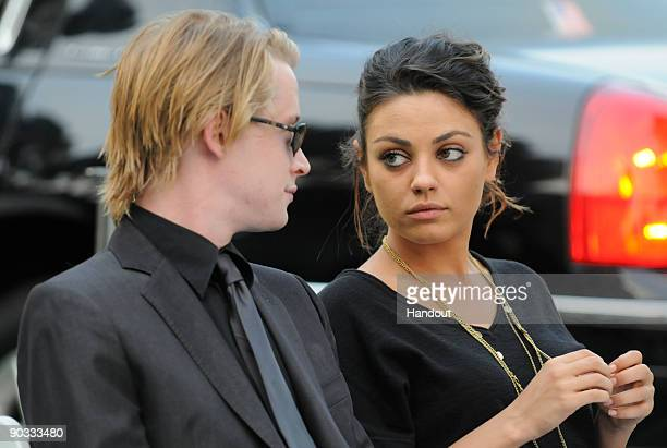 In this handout photo provided by Harrison Funk/The Jackson Family Actor Macaulay Culkin and Actress Mila Kunis attend Michael Jackson's funeral...