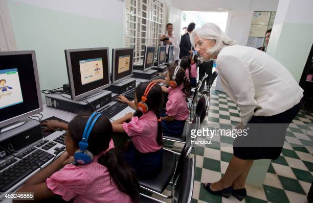 In this handout photo provided by IMF International Monetary Fund Managing Director Christine Lagarde watches school girls in the computer room at...