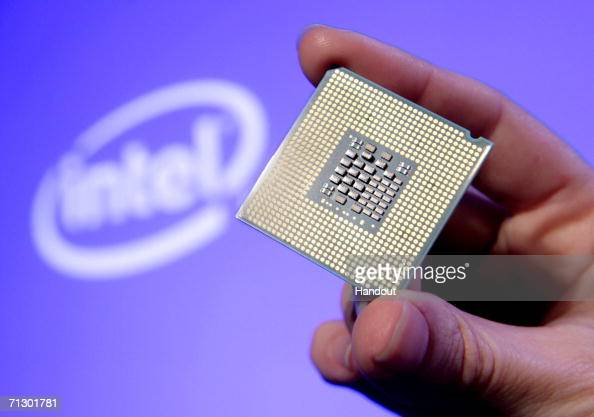 In this handout photo provided by Intel Tom Kilroy vice president of Intels Digital Enterprise Group displays Intel's new DualCore Xeon Processor...