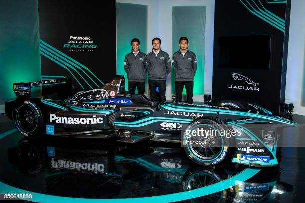 In this handout photo provided by Jaguar Racing Nelson Piquet Jr Mitch Evans and HoPin Tung pose with the new Jaguar Racing ITYPE 2 Formula E car...