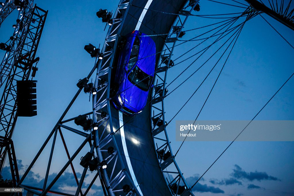 In this handout photo provided by Jaguar the Jaguar FPACE is unveiled as it drives round a giant loop the loop track on September 14 2015 in...