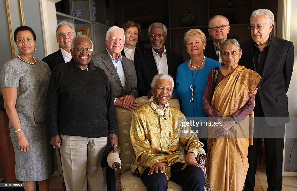 In this handout photo provided by Jeff Moore, Nelson Mandela is reunited with The Elders, from L-R Graca Machel, Fernando Henrique Cardoso, Desmond Tutu, Jimmy Carter, Mary Robinson, Kofi Annan, Gro Brundtland, Martti Ahtisaari, Ela Bhatt, Lakhdar Brahimi and Nelson Mandela (seated) on May 29, 2010 in Johannesburg, South Africa. Nelson Mandela, who founded The Elders in 2007, met members of the group at a private lunch in Johannesburg. The Elders, tasked by Mandela to be 'a fiercely independent and robust force for good' are holding one of their regular meetings in South Africa. (Photo by Jeff Moore via Getty Images) Archbishop Desmond Tutu, chair of the group said: ÒIt gives us such a strong sense of purpose and determination to sit with dear Madiba who brought us all together. We take his moral courage and his vision as our guide, to do what we can to address major causes of human suffering around the world.Ó