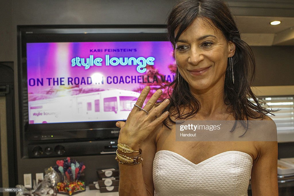 In this handout photo provided by Kari Feinstein PR, Perrey Reeves showing Jessica Robinson Jewelry's infinity ring attends the Kari Feinstein's style lounge on the road in the desert April 14, 2013 near Indio, California.