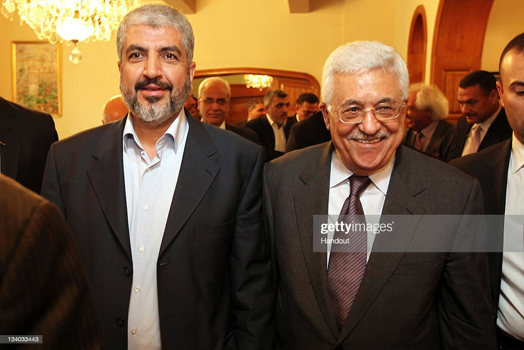 In this handout photo provided by Khaled Meshaal's Office of Media, Palestinian President and leader of Fatah Mahmoud Abbas (R) and the leader of Hamas Khaled Meshaal meet November 24, 2011 in Cairo, Egypt. The two leaders announced a new partnership between their two political parties.