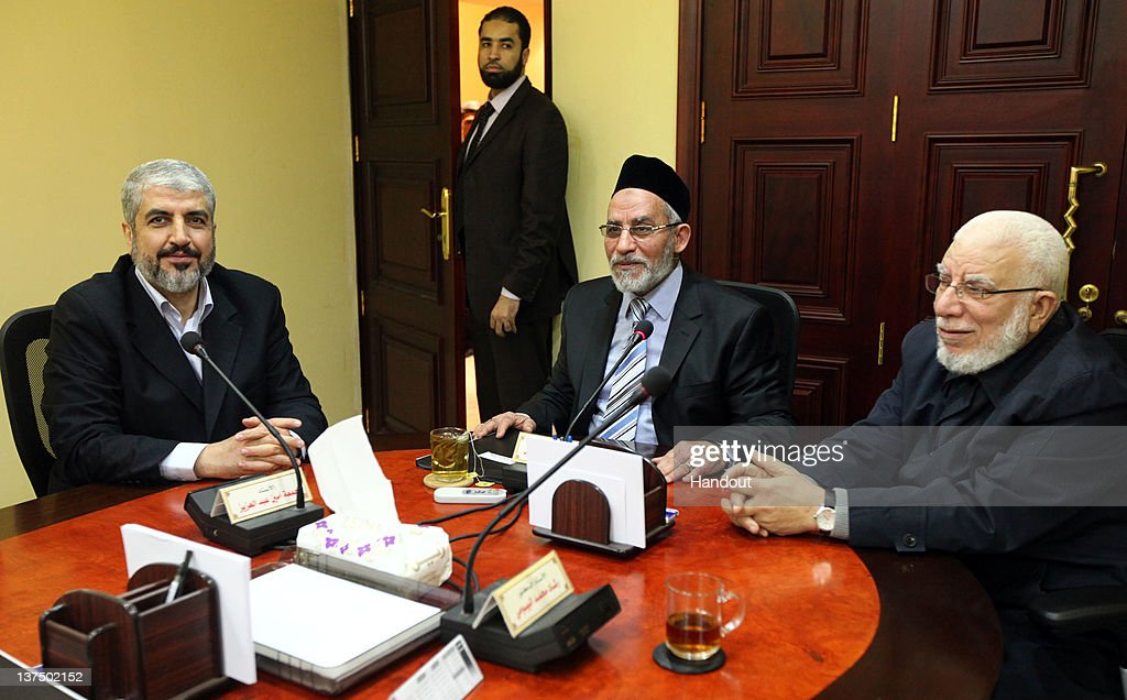 In this handout photo provided by Khaled Meshaal's Office of Media, the leader of Hamas Khaled Meshaal (L) meets with Supreme Leader of the Muslim Brotherhood Mohamed Badie (C) to congratulate him on their victory in the Egyptian Parliamentary elections on January 21, 2011 in Cairo, Egypt. Egypt's Islamists the Muslim Brotherhood who were once banned, ran as the Freedom and Justice Party and claimed two thirds of the seats in Egypt's first free elections in decades and since the dimise, almost a year ago, of their president Hosni Mubarak.
