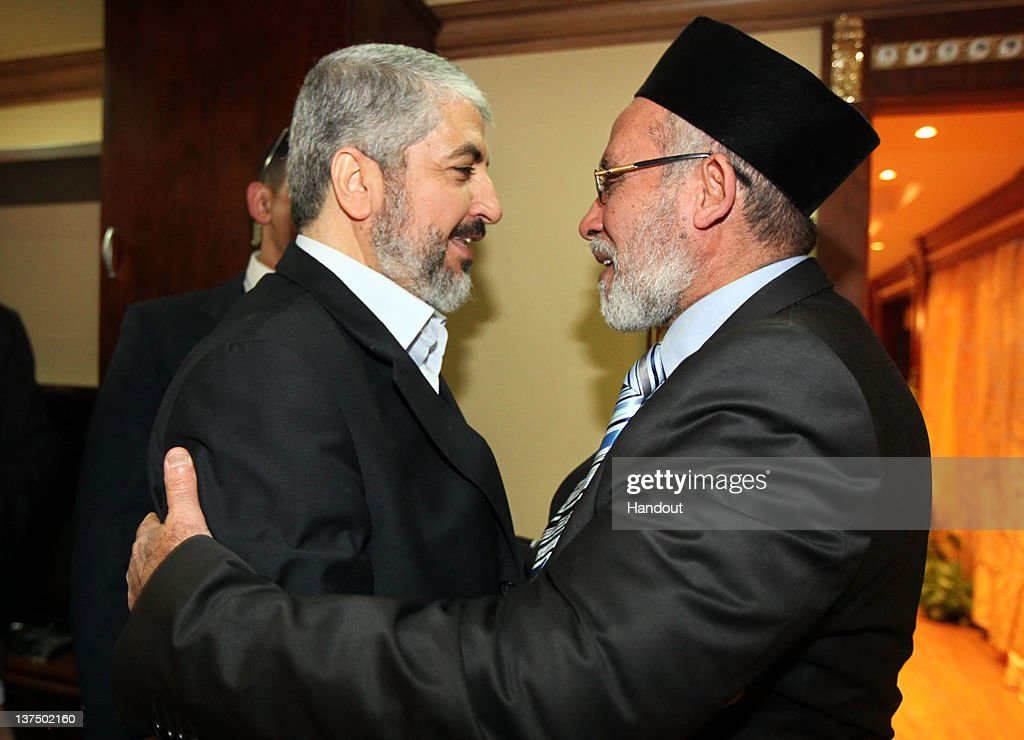 In this handout photo provided by Khaled Meshaal's Office of Media, the leader of Hamas Khaled Meshaal (L) meets with Supreme Leader of the Muslim Brotherhood Mohamed Badie (R) to congratulate him on their victory in the Egyptian Parliamentary elections on January 21, 2011 in Cairo, Egypt. Egypt's Islamists the Muslim Brotherhood who were once banned, ran as the Freedom and Justice Party and claimed two thirds of the seats in Egypt's first free elections in decades and since the dimise, almost a year ago, of their president Hosni Mubarak.