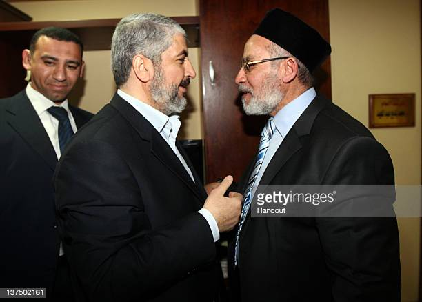 In this handout photo provided by Khaled Meshaal's Office of Media the leader of Hamas Khaled Meshaal meets with Supreme Leader of the Muslim...