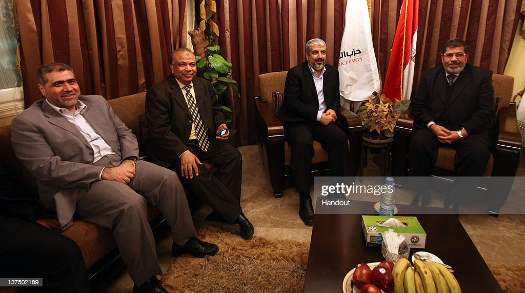 In this handout photo provided by Khaled Meshaal's Office of Media, the leader of Hamas Khaled Meshaal (2R) visits the headquarters of the Freedom and Justice Party to meet with their chairman Mohamed Morsy (R) to congratulate them on their victory in the Egyptian Parliamentary elections on January 21, 2011 in Cairo, Egypt. Egypt's Islamists the Muslim Brotherhood who were once banned, ran as the Freedom and Justice Party and claimed two thirds of the seats in Egypt's first free elections in decades and since the dimise, almost a year ago, of their president Hosni Mubarak.