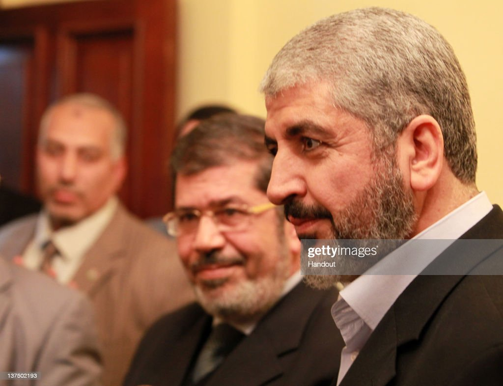 In this handout photo provided by Khaled Meshaal's Office of Media, the leader of Hamas Khaled Meshaal (R) visits the headquarters of the Freedom and Justice Party to meet with their chairman Mohamed Morsy (2R) to congratulate them on their victory in the Egyptian Parliamentary elections on January 21, 2011 in Cairo, Egypt. Egypt's Islamists the Muslim Brotherhood who were once banned, ran as the Freedom and Justice Party and claimed two thirds of the seats in Egypt's first free elections in decades and since the dimise, almost a year ago, of their president Hosni Mubarak.