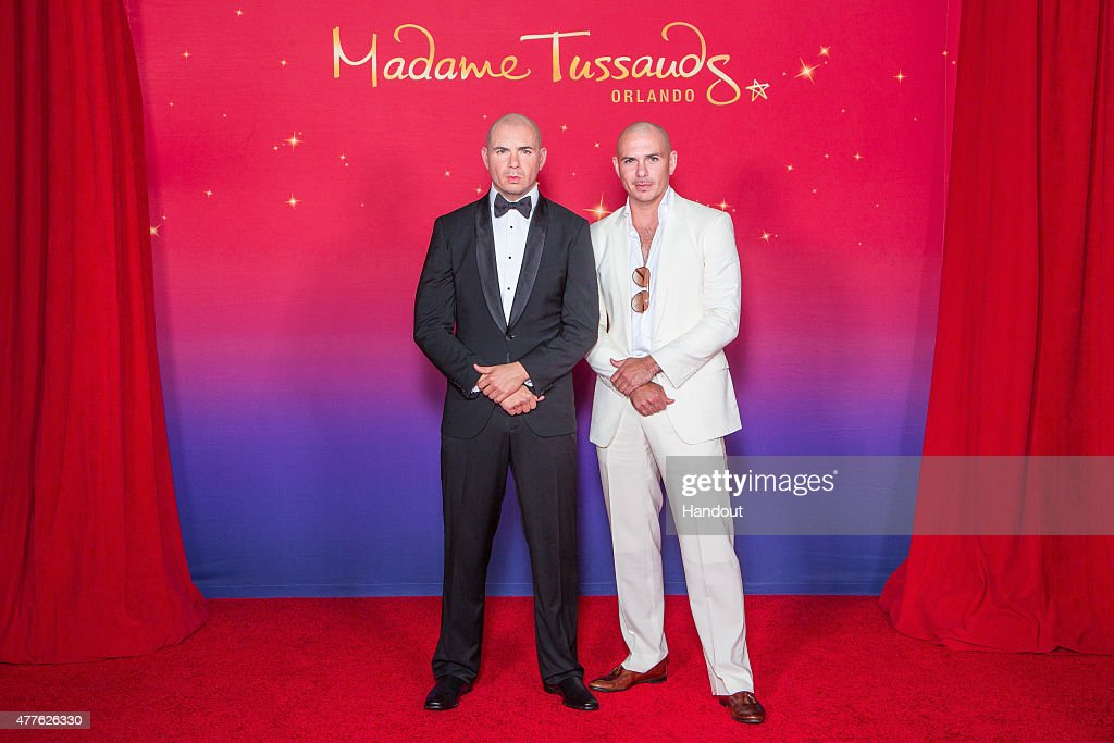 In this handout photo provided by Madame Tussauds Orlando, rapper <a gi-track='captionPersonalityLinkClicked' href=/galleries/search?phrase=Pitbull+-+Rapper&family=editorial&specificpeople=206389 ng-click='$event.stopPropagation()'>Pitbull</a> attends the unveiling of his wax likeness at Madame Tussauds May 29, 2015 in Orlando, Florida.