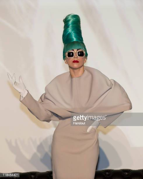 In this handout photo provided by Marina Bay Sands Lady Gaga showcases a new hairstyle at a press conference ahead of her Singapore performance on at...