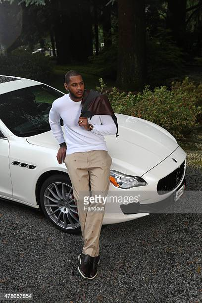 In this handout photo provided by Maserati Carmelo Anthony with the Maserati Quattroporte June 16 2015 at Lanificio Zegna Trivero Italy New York...