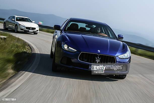 In this handout photo provided by Maserati Maseratis driving June 5 2015 in Trivero Italy New York Knicks basketball player and NBA AllStar Carmelo...