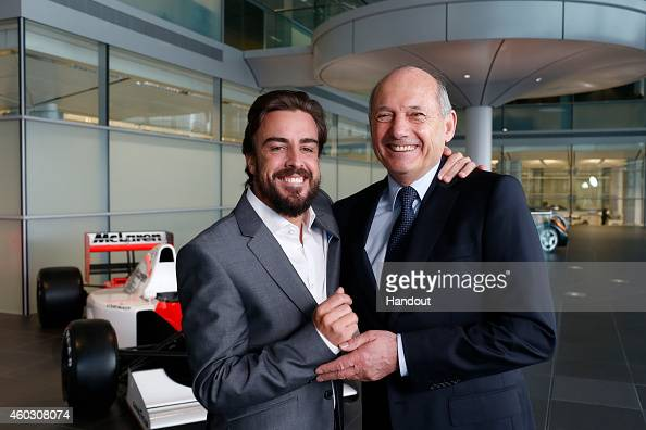 In this handout photo provided by McLarenHonda Formula One driver Fernando Alonso poses with Ron Dennis Chairman Chief Executive Officer McLaren as...