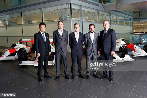 In this handout photo provided by McLarenHonda Formula One drivers Fernando Alonso and Jenson Button pose as McLarenHonda announces its new driver...