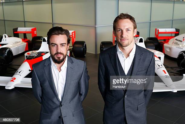 In this handout photo provided by McLarenHonda Formula One drivers Fernando Alonso and Jenson Button pose together as McLarenHonda announces its new...