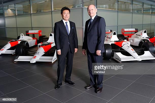 In this handout photo provided by McLarenHonda Ron Dennis Chairman Chief Executive Officer McLaren and Yasuhisa Arai Senior Managing Officer Honda RD...