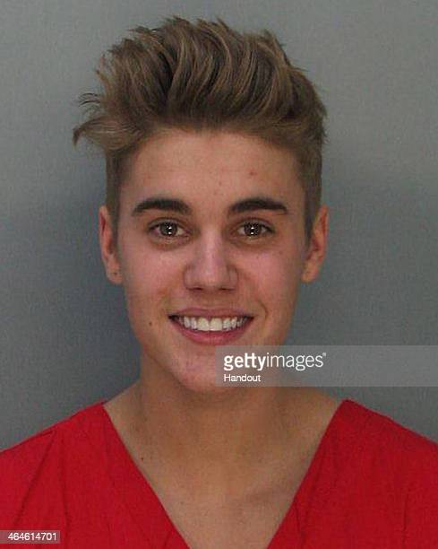 In this handout photo provided by MiamiDade Police Department pop star Justin Bieber poses for a booking photo at the MiamiDade Police Department on...